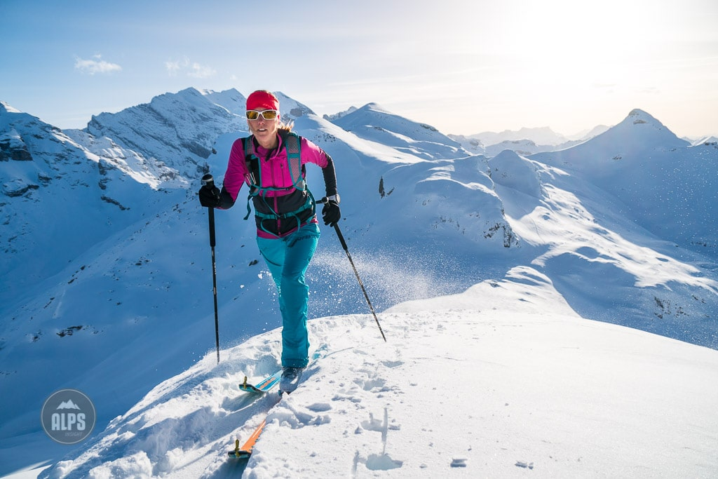 A woman ski mountaineering, or skimo training, in the Jungfrau Region of Switzerland.